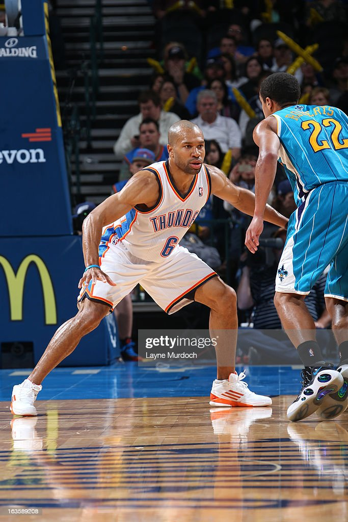 Derek Fisher #6 of the Oklahoma City Thunder defends against Brian Roberts #22 of the New Orleans Hornets on February 27, 2013 at the Chesapeake Energy Arena in Oklahoma City, Oklahoma.