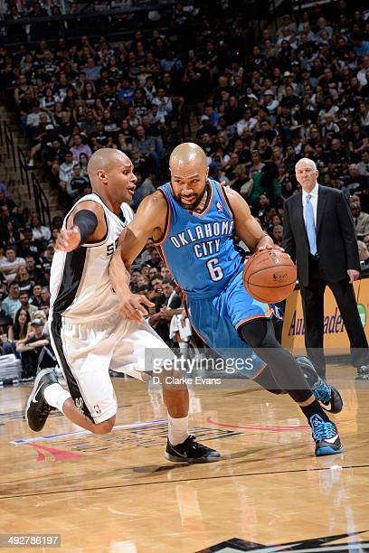 Derek Fisher of the Oklahoma City Thunder drives to the basket against The San Antonio Spurs in Game Two of the Western Conference Finals during the...