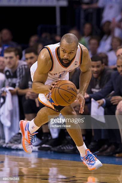 Derek Fisher of the Oklahoma City Thunder handles the ball against the San Antonio Spurs in Game 6 of the Western Conference Finals during the 2014...