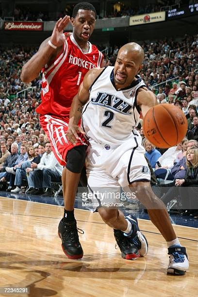 Derek Fisher of the Utah Jazz drives to the basket against Tracy McGrady of the Houston Rockets November 01 2006 at the Delta Center in Salt Lake...