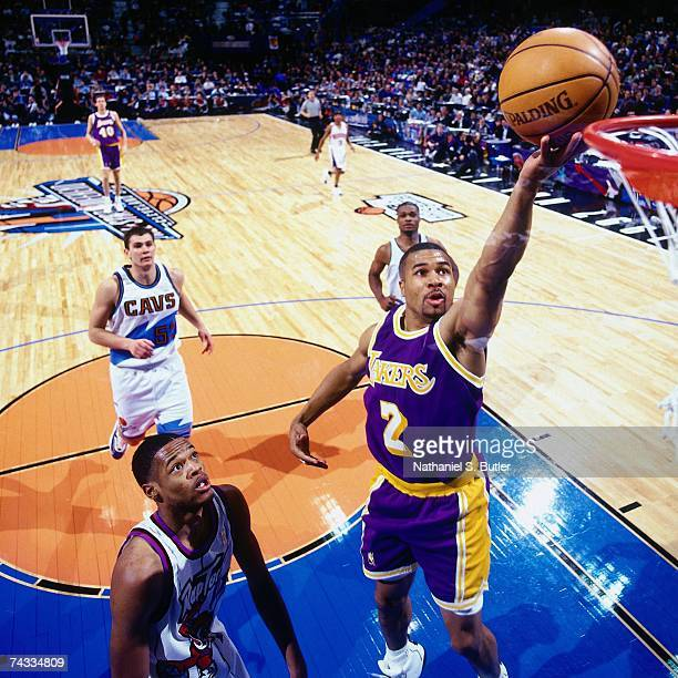 Derek Fisher of the Western Conference attempts a layup against the Eastern Conference during the 1997 Rookie AllStar game played February 8 1997 at...