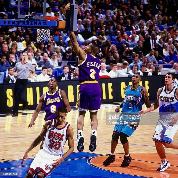 Derek Fisher of the Western Conference attempts a layup against the Eastern Conference during the 1997 Rookie Game played February 8 1997 at the Gund...