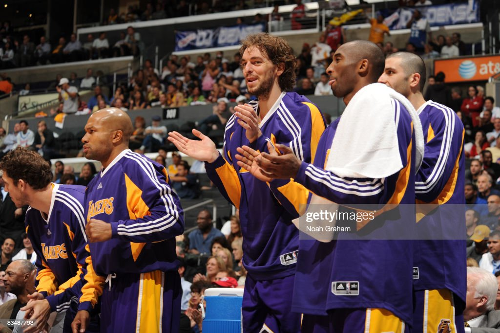 Derek Fisher #2, Pau Gasol #16, Kobe Bryant #24, and Vladimir Radmanovic #10 of the Los Angeles Lakers cheer on their team during the game against the Los Angeles Clippers at Staples Center on October 29, 2008 in Los Angeles, California.