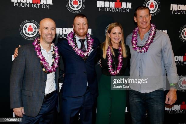 Derek Fitzgerald Mike Ergo Shannon Spake and Don Davey pose for a photo on the red carpet during the IRONMAN World Championship Broadcast Premiere at...