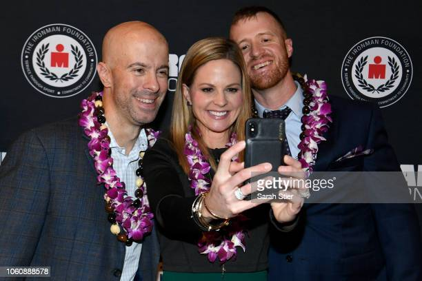 Derek Fitzgerald Shannon Spake and Mike Ergo take a selfie on the red carpet during the IRONMAN World Championship Broadcast Premiere at the...