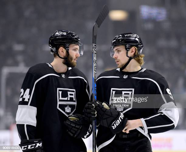 Derek Forbort and Adrian Kempe of the Los Angeles Kings talk before the opening faceoff against the Pittsburgh Penguins at Staples Center on January...