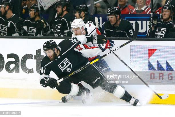 Derek Forbort of the Los Angeles Kings and Travis Boyd of the Washington Capitals fight for control of the puck during the first period at Staples...