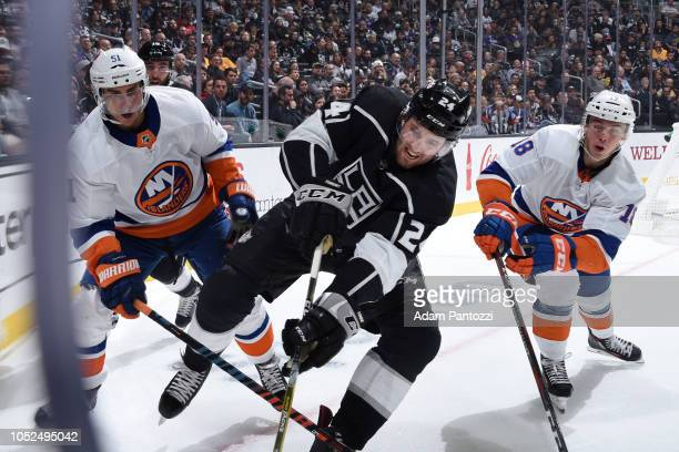 Derek Forbort of the Los Angeles Kings battles for the puck with Valtteri Filppula and Anthony Beauvillier of the New York Islanders during the...