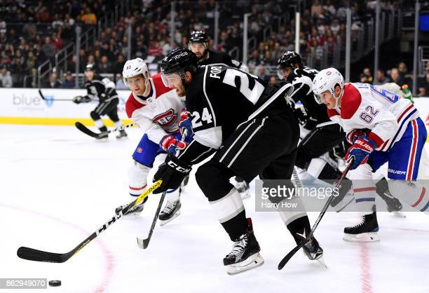 Derek Forbort of the Los Angeles Kings gains control of the puck in front of Ales Hemsky and Artturi Lehkonen of the Montreal Canadiens during the...