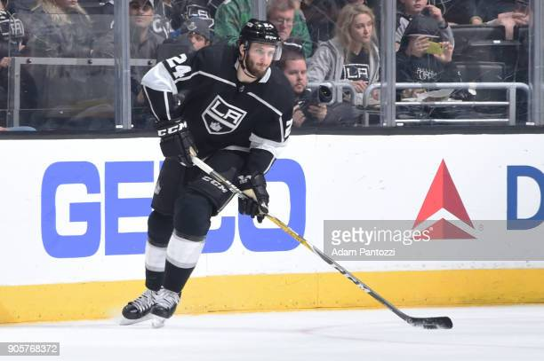 Derek Forbort of the Los Angeles Kings handles the puck during a game against the San Jose Sharks at STAPLES Center on January 15 2018 in Los Angeles...