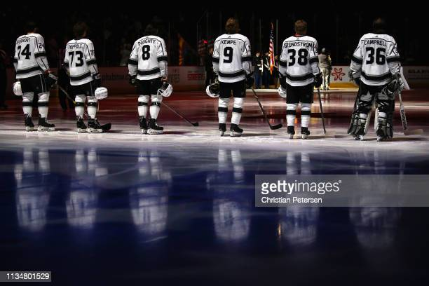 Derek Forbort Tyler Toffoli Drew Doughty Adrian Kempe Carl Grundstrom and goaltender Jack Campbell of the Los Angeles Kings stand attended for the...