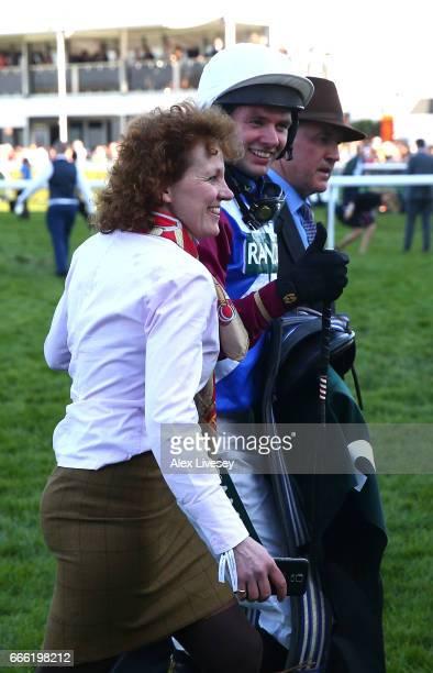 Derek Fox jockey of One For Arthur and trainer Lucinda Russell celebrate winning the 2017 Randox Heath Grand National at Aintree Racecourse on April...
