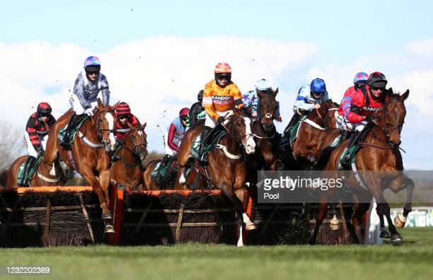 Derek Fox riding Ahoy Senor leads on the first lap of the Doom Bar Sefton Novices' Hurdle during Ladies Day of the 2021 Randox Health Grand National...