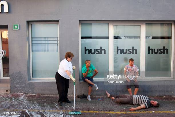 Derek from Hull waits for an ambulance to arrive with a man he discovered in distress in the West End area of San Antonio Ibiza