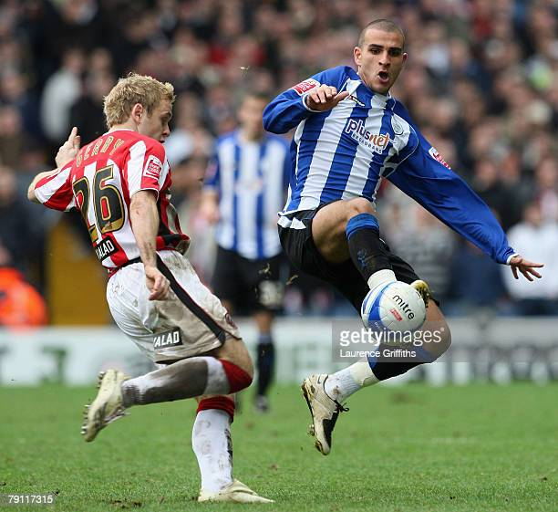 Derek Geary of Sheffield United battles with Marcus Tudgay of Sheff Wed during the Coca Cola Championship match between Sheffield Wednesday and...