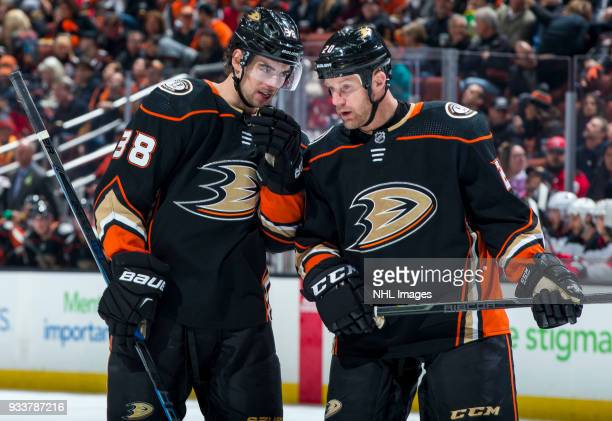 Derek Grant and Jason Chimera of the Anaheim Ducks talk during the first period of the game against the New Jersey Devils at Honda Center on March 18...