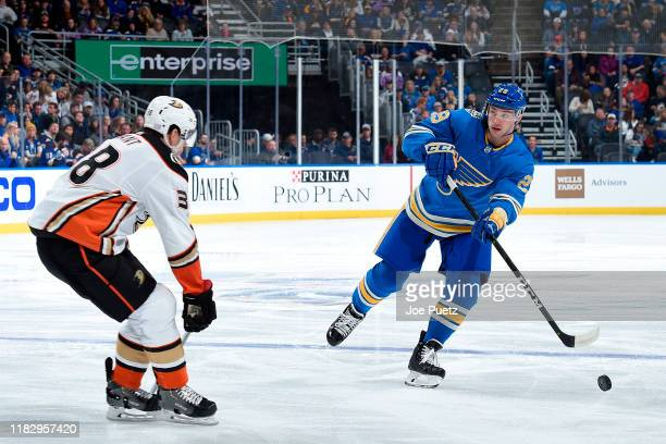 Derek Grant of the Anaheim Ducks attempts to block a pass from Vince Dunn of the St. Louis Blues at Enterprise Center on November 16, 2019 in St....