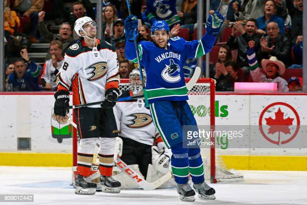 Derek Grant of the Anaheim Ducks looks on as Brandon Sutter of the Vancouver Canucks celebrates after scoring during their NHL game at Rogers Arena...