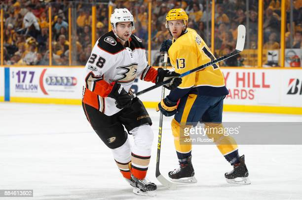 Derek Grant of the Anaheim Ducks skates against Nick Bonino of the Nashville Predators during an NHL game at Bridgestone Arena on December 2 2017 in...
