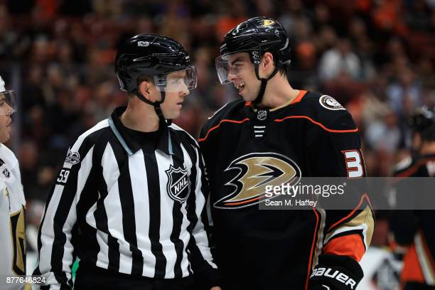 Derek Grant of the Anaheim Ducks talks with linesman Steve Barton during the second period of a game at Honda Center on November 22 2017 in Anaheim...