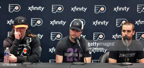 Derek Grant Scott Laughton and Matt Niskanen of the Philadelphia Flyers speak to the media after being defeated 20 by the Boston Bruins on March 10...