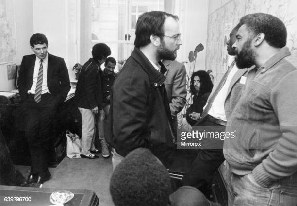 Derek Hatton looks on as he is imprisoned in his council office by members of the Black Caucus along with Tony Mulhearn and Sam Bond and told clearly...