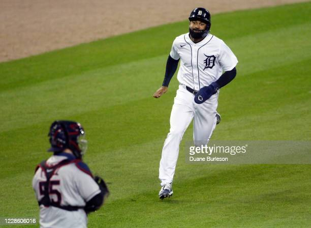 Derek Hill of the Detroit Tigers scores from second base on a single by Eric Haase to tie the game against the Cleveland Indians at 22 during the...