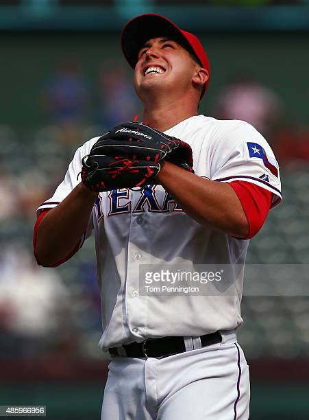 Derek Holland of the Texas Rangers celebrates after throwing a complete game shutout turnover beat the Baltimore Orioles 60 at Globe Life Park in...