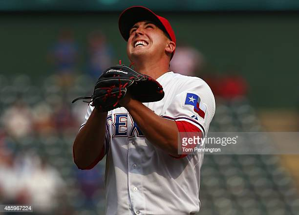 Derek Holland of the Texas Rangers celebrates after throwing a complete game shutout to beat the Baltimore Orioles 60 at Globe Life Park in Arlington...