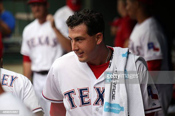 Derek Holland of the Texas Rangers in the dugout before the start of the game against the Seattle Mariners at Global Life Park in Arlington on...