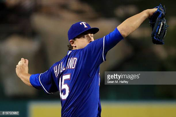 Derek Holland of the Texas Rangers pitches against the Los Angeles Angels of Anaheim during the first inning of a baseball game against the Texas...