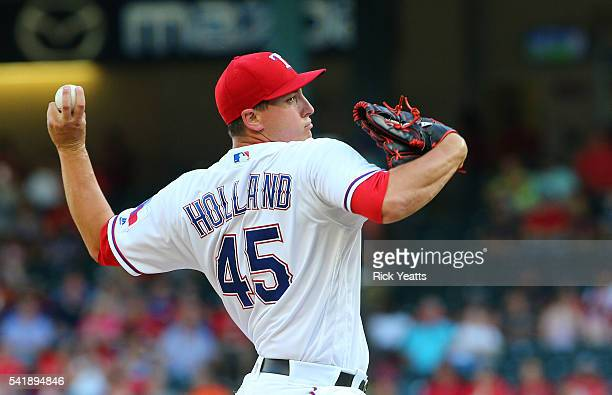 Derek Holland of the Texas Rangers throws the first inning against the Baltimore Orioles at Globe Life Park in Arlington on June 20 2016 in Arlington...
