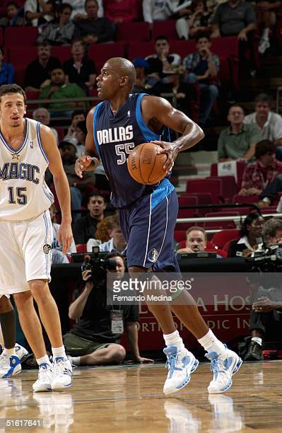 Derek Hood of the Dallas Mavericks looks to make a play on the dribble against the Orlando Magic during the preseason game at TD Waterhouse Centre on...