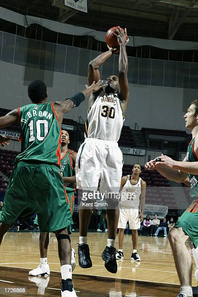 Derek Hood of the Mobile Revelers shoots a jump shot over Damone Brown of the North Charleston Lowgators during the game at the North Charleston...