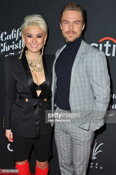 Derek Hough and Agnez Mo attend A California Christmas at The Grove Presented by Citi on November 12 2017 in Los Angeles California