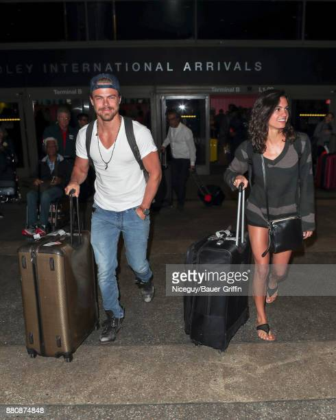 Derek Hough and Hayley Erbert are seen at Los Angeles International Airport on November 27 2017 in Los Angeles California