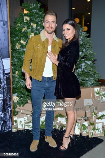 Derek Hough and Hayley Erbert attend the GUESS Holiday 2018 Event on November 7 2018 in West Hollywood California