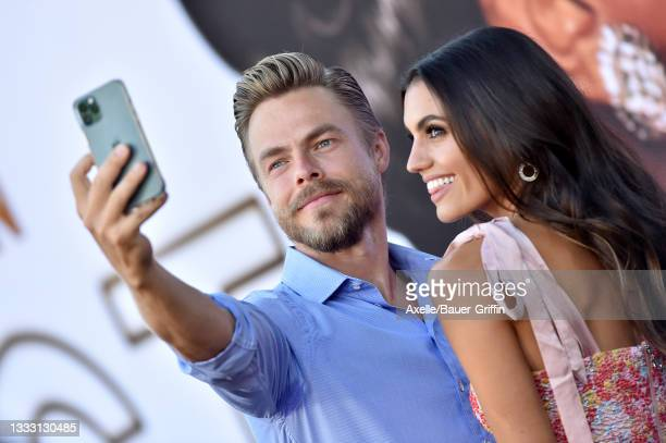 """Derek Hough and Hayley Erbert attend the Los Angeles Premiere of MGM's """"Respect"""" at Regency Village Theatre on August 08, 2021 in Los Angeles,..."""