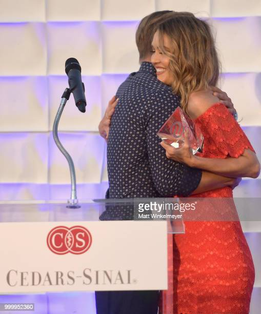 Derek Hough and honoree Amy Purdy speaks onstage during the 33rd Annual CedarsSinai Sports Spectacular at The Compound on July 15 2018 in Inglewood...
