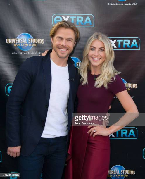 """Derek Hough and Julianne Hough visit """"Extra"""" at Universal Studios Hollywood on March 7, 2017 in Universal City, California."""