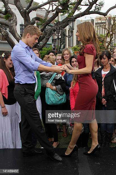 Derek Hough and Maria Menounos dance together at Extra at The Grove on March 16 2012 in Los Angeles California