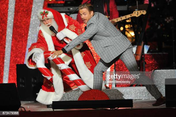 Derek Hough and Santa Clause turn on a giant Christmas Tree at A California Christmas at The Grove Presented by Citi on November 12 2017 in Los...