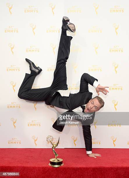 Derek Hough cowinner of the award for Outstanding Choreography for Dancing with the Stars poses in the press room during the 2015 Creative Arts Emmy...