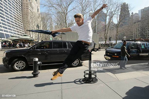 """Derek Hough poses with a Hilton Hotels Resorts """"StoryFinder"""" in New York City inspiring people to use the power of visualization to realize their..."""