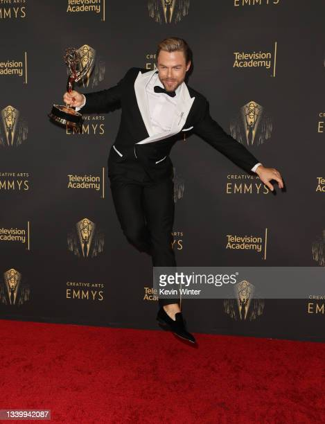 """Derek Hough poses with the award for Outstanding Choreography for Variety or Reality Programming for """"Dancing With The Stars"""" at the Creative Arts..."""
