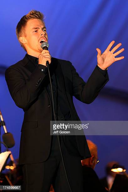 Derek Hough sings 'Feeling Good' during the California Philharmonic Festival on the Green at Santa Anita Race Track on July 27 2013 in Arcadia...