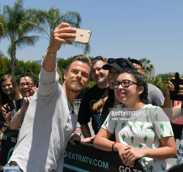 Derek Hough takes a selfie with fans at 'Extra' at Universal Studios Hollywood on June 25 2018 in Universal City California