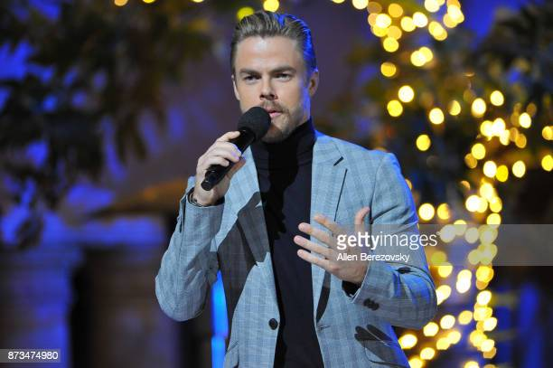 Derek Hough talks onstage during A California Christmas at The Grove Presented by Citi on November 12 2017 in Los Angeles California