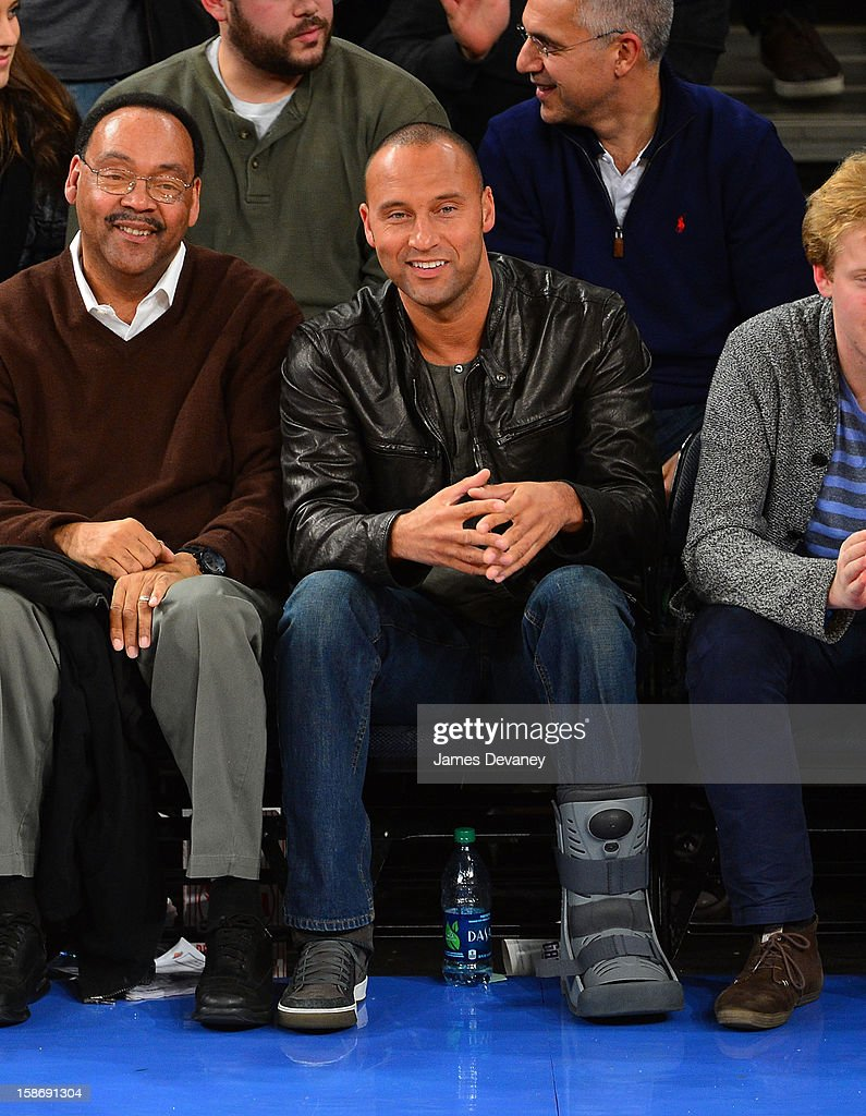 Derek Jeter and father, Sanderson Jeter attend the Minnesota Timberwolves vs New York Knicks game at Madison Square Garden on December 23, 2012 in New York City.