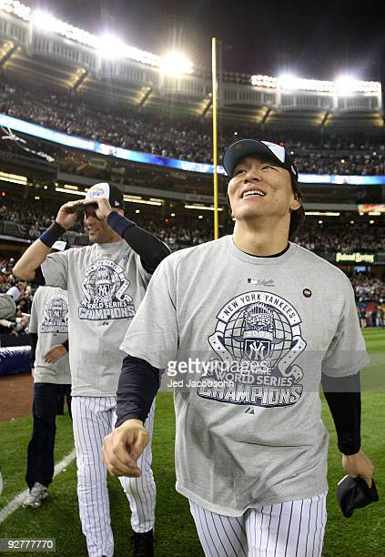 Derek Jeter and Hideki Matsui of the New York Yankees celebrate on the field after their 7-3 win against the Philadelphia Phillies in Game Six of the...